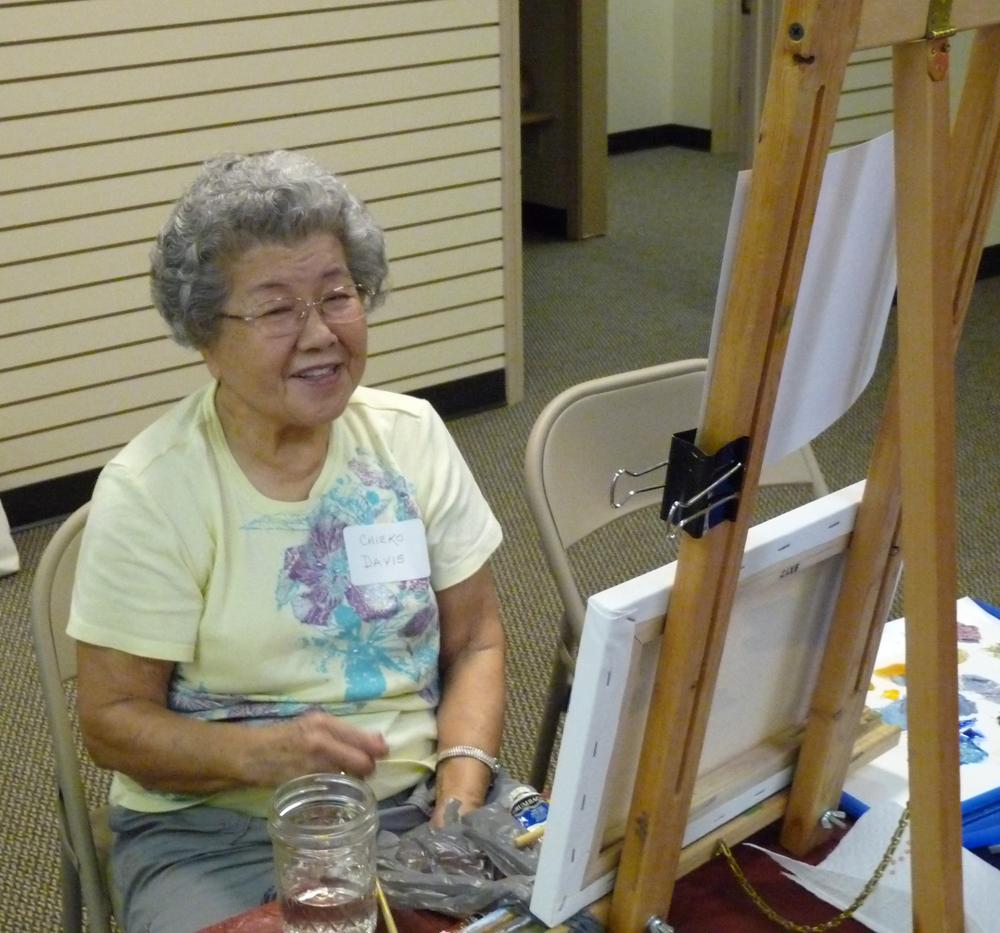 Chieko Davis enjoying working on her painting.