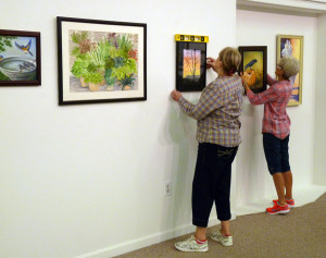 Joyce LuPresto and Elizabeth O'Rear Hanging the 2015 CKAG All Member Show