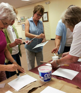 CKAG members preparing boards with watercolor ground for painting next month